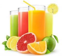 Fresh citrus juices isolated on white